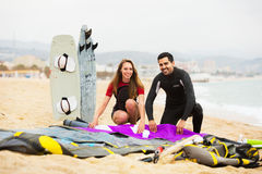 Family in wetsuits with surf boards Stock Images