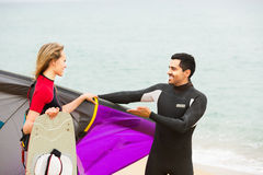 Family in wetsuits with surf boards Royalty Free Stock Photo