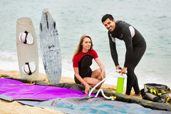 Family in wetsuits with surf boards Stock Photography
