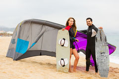 Family in wetsuits with surf boards Stock Image