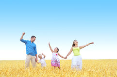 Family in a wheat field Stock Images
