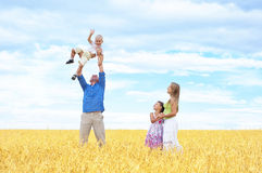Family in a wheat field Royalty Free Stock Photos