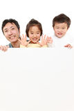 Family with a white board Royalty Free Stock Photos