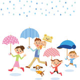 The family who puts up the umbrella Stock Photos
