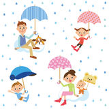 The family who puts up the umbrella Royalty Free Stock Images