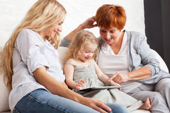 Family wiht tablet computer at sofa Stock Photo