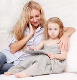 Family wiht tablet at sofa Stock Photo