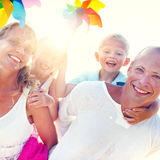 Family Windmill Sea Vacation Holiday Piggyback Concept.  Royalty Free Stock Images