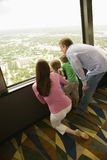 Family at window. Stock Photo