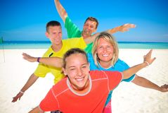 Family with wings. On Cancun beach Royalty Free Stock Images