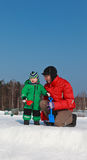 Family winter. Father and baby in winter nature Royalty Free Stock Photo