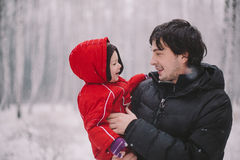 Family on winter background Stock Images