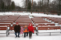 Family on winter bench. In auditorium royalty free stock images