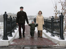 Family on winter bridge Stock Image
