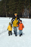 Family in winter forest Stock Image
