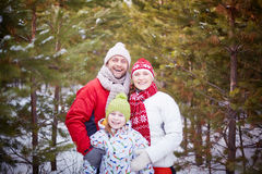 Family in winter forest Royalty Free Stock Images