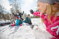 Family on winter holiday having fun. Family on winter holiday making snowballs and having fun Royalty Free Stock Photos