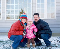 Family in the Winter at Home Stock Images