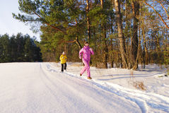 Family winter jogging Royalty Free Stock Photography