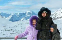 Family on winter mountain background (Austria). Royalty Free Stock Photos