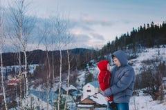 Family on winter mountain background Royalty Free Stock Photos