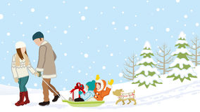 Family in Winter nature -Parents carrying children by the sled Stock Images