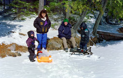 Family Winter Outing Ontario Canada. Family enjoys a winter outing on an island in a frozen Ontario lake stock image