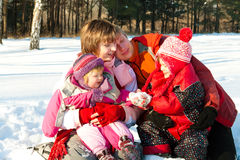Family in winter park Stock Image