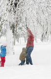 Family in winter park Royalty Free Stock Photography
