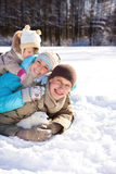 Family in winter park. Happy young family enjoying their weekend in a winter park Stock Image