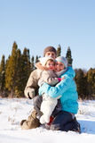 Family in winter park. Happy young family of three in winter park Stock Photography