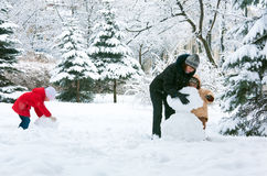 Family in winter park. Happy family (mother with small boy and girl) in winter city park Stock Photography