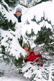 Family in winter park Royalty Free Stock Image