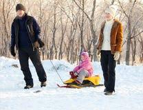 Family  in a winter park Stock Photos