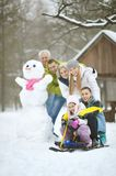 Family in winter park. Big happy family having fun in winter park covered with snow Royalty Free Stock Photos