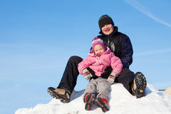 Family in winter park. Father with daughter outdoors Stock Image