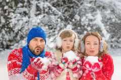 Family in winter park. Happy family playing outdoors. People having fun in winter park Stock Photo