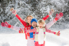 Family in winter park Royalty Free Stock Photo