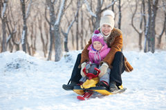 Family in a winter park Stock Photography