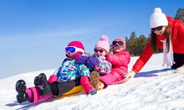 Family winter playing stock image