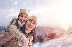 Family and winter season Stock Photos
