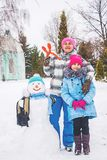 Family winter snowman made Stock Images