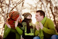 Family in winter time having fun Royalty Free Stock Image