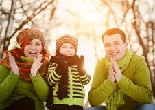 Family in winter time having fun Stock Images