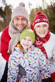 Family in winter-wear Royalty Free Stock Photo