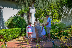 Family at the Wishing Well Royalty Free Stock Photos