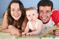 Family With Baby Read Book Royalty Free Stock Photo