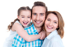 Family With Little Girl And Pretty White Smiles Stock Photos