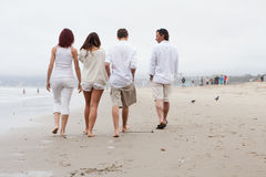 Family wlking away on the Beach Stock Image