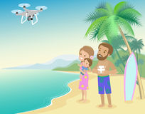 Family woman man mother father and kid child son on seashore with palm  serfboard vacation launch drone quadrocopter to take photo Royalty Free Stock Photography